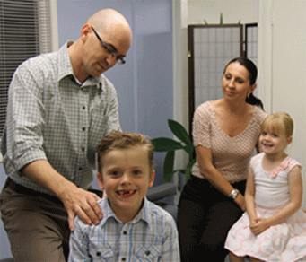Chiropractor Dr Malone in family consultation